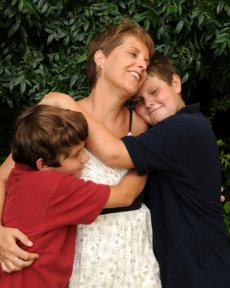 Family Mom and Sons Hugging and Happy